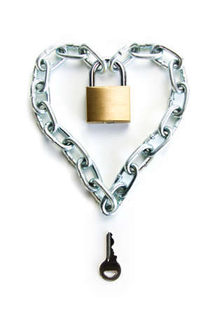 A Padlocked Chain Shaped Lock a Heart and the Key to Open It photo
