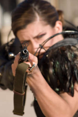 anachronistic: Science fiction woman from the future aiming a rifle.