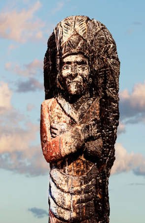 headress: Burnt statue of a Native American Chief. Stock Photo