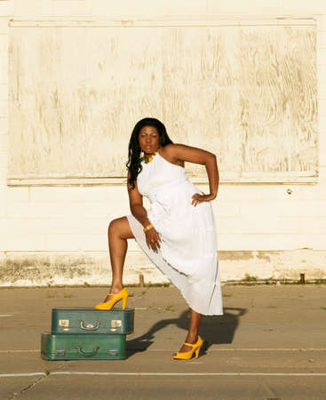 African American woman showing her leg along the side of a road. Stock Photo