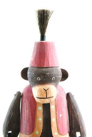 medium shot: Wooden monkey in a vest and fez medium shot isolated on pure white.