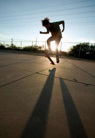 Teenage boy skateboarder with his board. photo