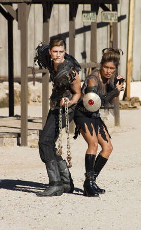 Tough science-fiction women in costumes with weapons. photo