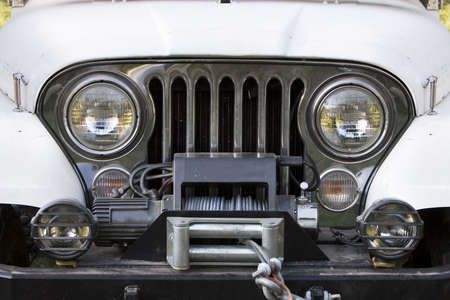 grille: Front end, headlights and grille on a vintage four-wheel drive vehicle. Stock Photo