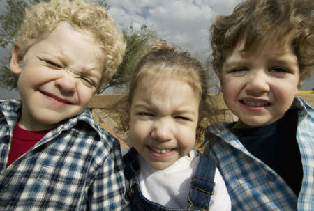 triplet: Triplets make faces in a wide angle portrait