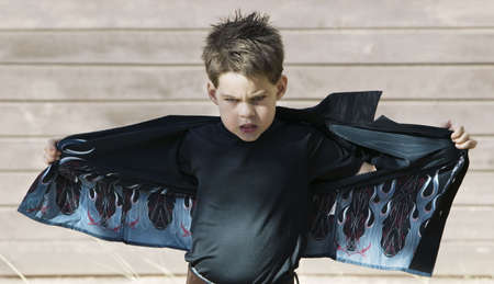 stretched out: Young boy with his shirt stretched out like wings Stock Photo