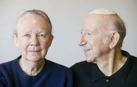 Close-up of elderly Jewish couple in studio. 스톡 콘텐츠