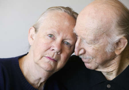 Close-up of senior couple focusing on worried woman photo