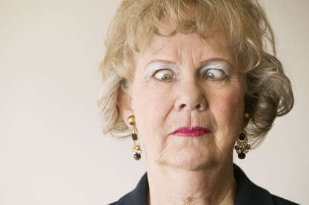 Close-up of a senior woman crossing her eyes. photo