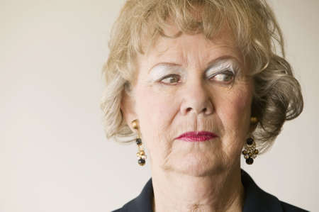 matron: Close-up of a senior woman looking off to the right. Stock Photo
