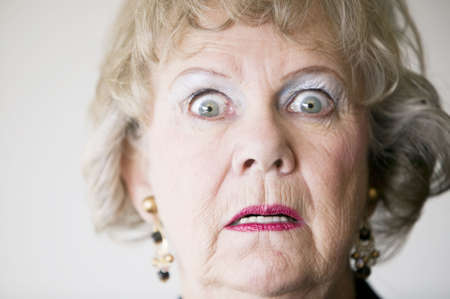 matron: Close-up of a senior woman with a horrified look on her face.