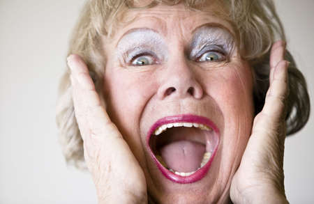 agape: Close-up of a senior woman with her mouth open screaming.