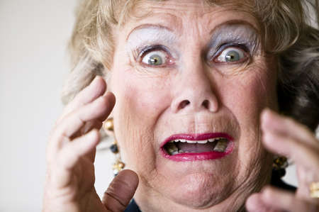 horrified: Close-up of a horrified senior woman with her mouth open. Stock Photo