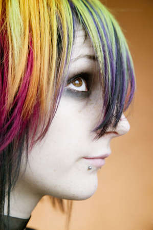 Close-up of an alternative girl with multi-colred hair looking up Stock Photo - 2506505