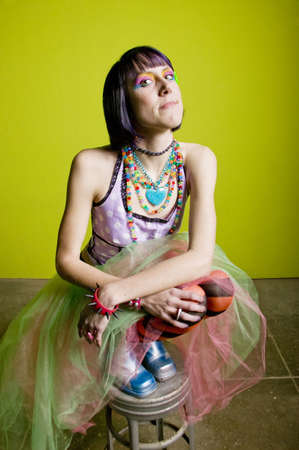 Pretty young woman with colorful punk clothes. photo