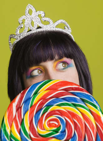 Pretty young woman with a large colorful lollipop Stock Photo - 2514949