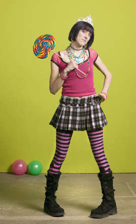 Pretty young woman holding a large lollipop photo