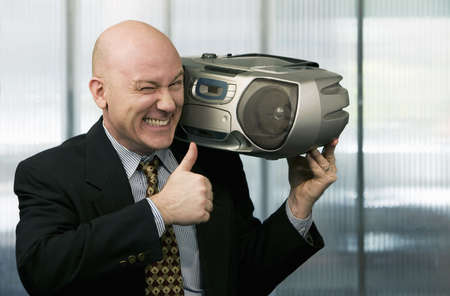 Bald businessman listening to a boom box photo