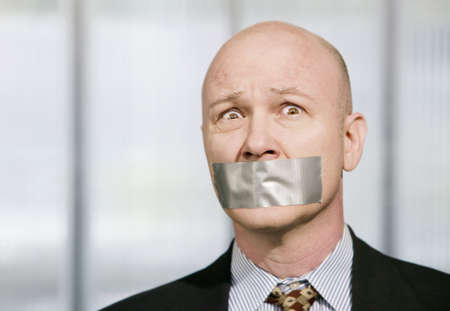 Worried businessman silenced with duct tape over his mouth Stock Photo - 2711753