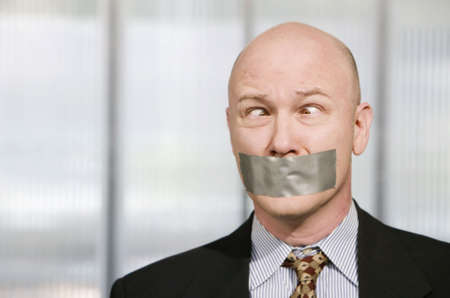 silenced: Cross-eyed businessman silenced with duct tape over his mouth