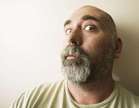 Portrait of a suspicious bald man with a beard. Stok Fotoğraf