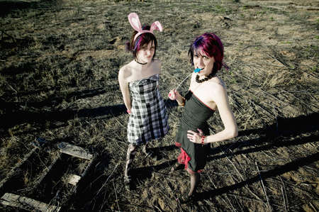 Two punk girls posing in a rural setting photo