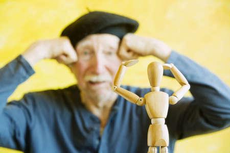 Crazy artist pmimics a wooden figure model
