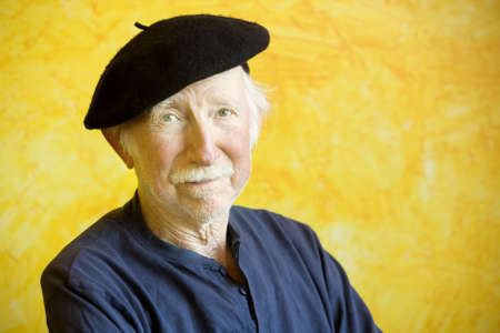 Portrait of an elderly painter wearing a beret