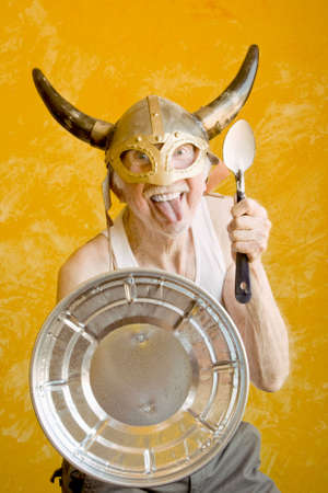 Crazy Old Man in a Tee-Shirt and a Viking Helmet