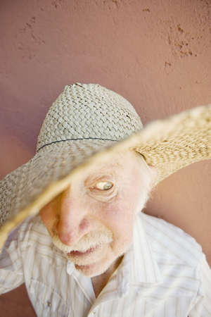 crazy man: Senior Citizen Man with a Funny Expression Wearing a Straw Cowboy Hat