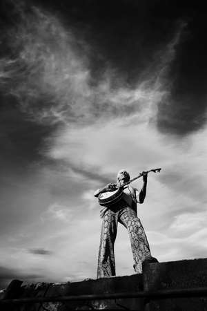 Banjo Player with groovy clothes against a wide sky Stock Photo - 3150352