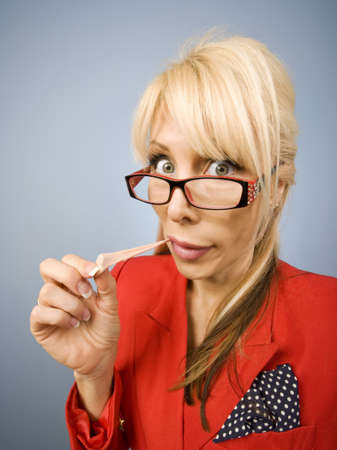 obnoxious: Woman in red pulling gum out of her mouth
