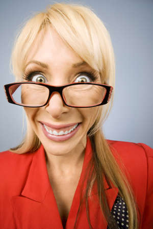 big smile: Happy woman wearing glasses in red with a big smile