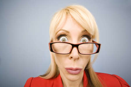Woman in red pursing her lips and making a funny face Stock Photo - 3234851