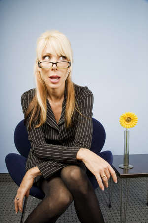 Businesswoman looking over the top of her glasses photo