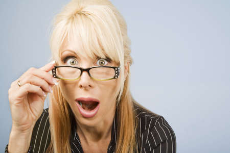 agape: Businesswoman looking over the top of her glasses
