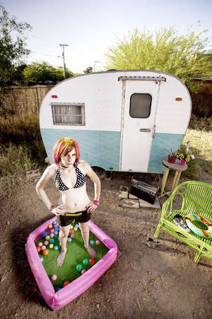 pierce: Woman standing in a play pool outside a trailer