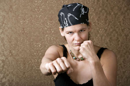 unruly: Pretty Boxing Woman Wearing a Bandana on Her Head