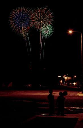 Long exposure of fireworks over an urban street scene Stock Photo - 3264418