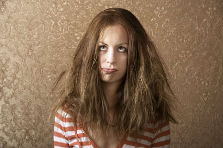 bad hair: Portrait of a young woman with messy long hair Stock Photo