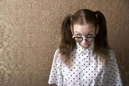 dweeb: Cute Nerdy Girl Leaning Against a Wall