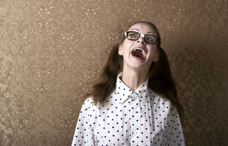 dweeb: Cute Nerdy Girl Leaning Against a Wall Laughing