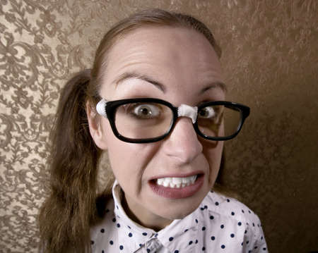 dweeb:  Wide Angle Portrait of a Nervous Nerdy Girl  Stock Photo