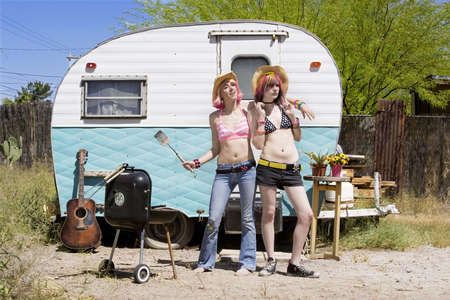 Two Young Punk Women in Front of a Trailer photo