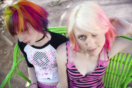 Two Pretty Punk Girls on a Green Bench photo