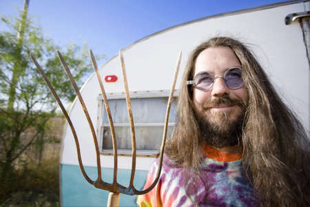 long: Friendly Hippie with Long Hair and a Pitchfork