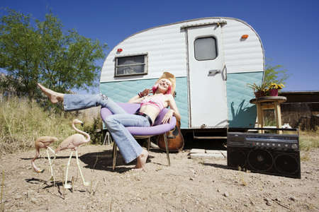 barefoot cowboy: Pretty Woman in a Cowboy Hat in Front of a Travel Trailer