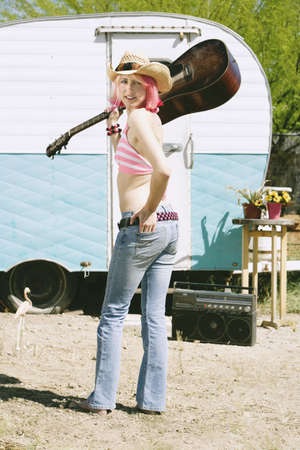 barefoot cowboy: Pretty Woman Front of Vintage Travel Trailer with a Guitar