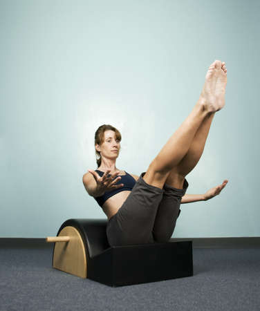 calisthenics: Athletic Woman Exercising and Balancing on Gym Equipment Stock Photo