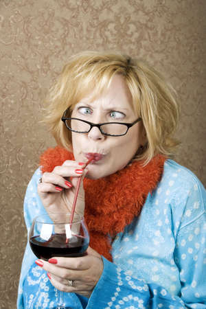 tawdry: Crazy woman with crossed eyes drinking wine through a straw